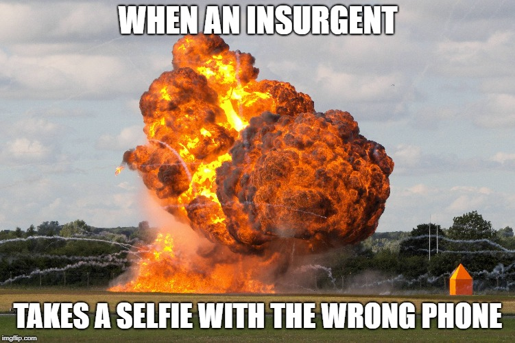 WHEN AN INSURGENT TAKES A SELFIE WITH THE WRONG PHONE | image tagged in terrorists,funny | made w/ Imgflip meme maker
