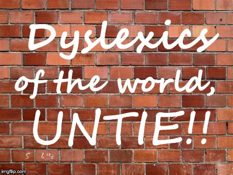 graffiti | Dyslexics of the world, UNTIE!! | image tagged in puns,protest,brick wall,graffiti | made w/ Imgflip meme maker