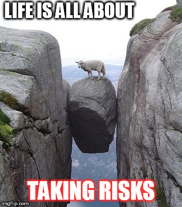 Between a rock and a hard place | LIFE IS ALL ABOUT TAKING RISKS | image tagged in between a rock and a hard place | made w/ Imgflip meme maker