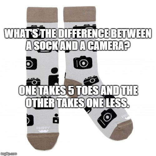 camera socks | WHAT'S THE DIFFERENCE BETWEEN A SOCK AND A CAMERA? ONE TAKES 5 TOES AND THE OTHER TAKES ONE LESS. | image tagged in bad foot pun,sock pun,camera pun,funny meme | made w/ Imgflip meme maker