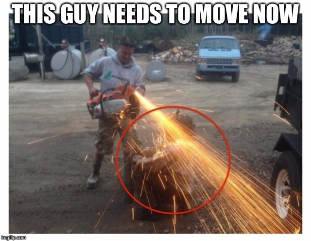 This guy could die | THIS GUY NEEDS TO MOVE NOW | image tagged in stupid,people,fire | made w/ Imgflip meme maker