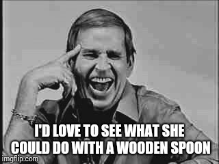 Laughing Paul Lynde | I'D LOVE TO SEE WHAT SHE COULD DO WITH A WOODEN SPOON | image tagged in laughing paul lynde | made w/ Imgflip meme maker