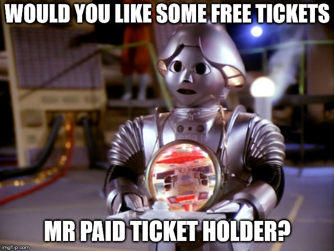 WOULD YOU LIKE SOME FREE TICKETS MR PAID TICKET HOLDER? | image tagged in useless robot | made w/ Imgflip meme maker