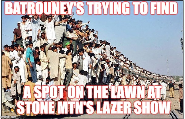 BATROUNEY'S TRYING TO FIND A SPOT ON THE LAWN AT STONE MTN'S LAZER SHOW | image tagged in crowded train | made w/ Imgflip meme maker