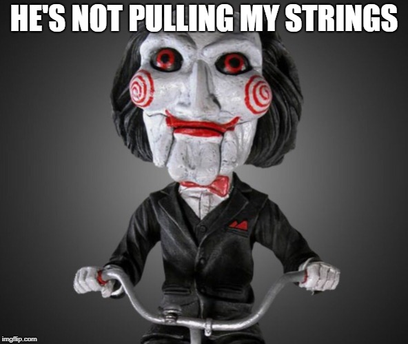 Saw puppet | HE'S NOT PULLING MY STRINGS | image tagged in saw puppet | made w/ Imgflip meme maker