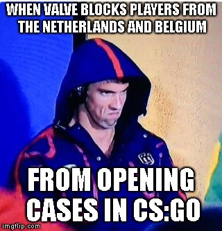 Michael Phelps Death Stare Meme | WHEN VALVE BLOCKS PLAYERS FROM THE NETHERLANDS AND BELGIUM FROM OPENING CASES IN CS:GO | image tagged in memes,michael phelps death stare | made w/ Imgflip meme maker