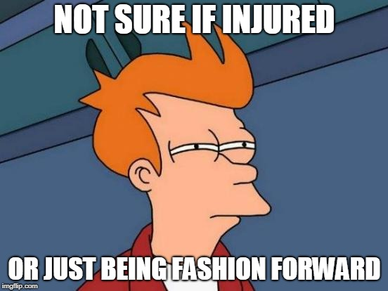 Futurama Fry Meme | NOT SURE IF INJURED OR JUST BEING FASHION FORWARD | image tagged in memes,futurama fry,AdviceAnimals | made w/ Imgflip meme maker
