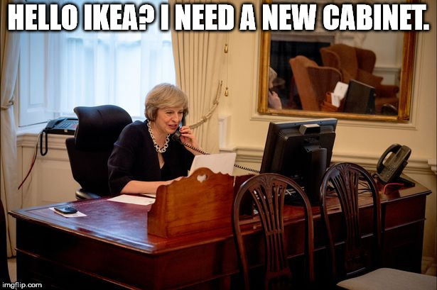 Theresa is in deep trouble. Half her cabinet has resigned over Brexit. | HELLO IKEA? I NEED A NEW CABINET. | image tagged in theresa may,phone | made w/ Imgflip meme maker