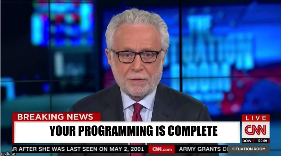 YOUR PROGRAMMING IS COMPLETE | image tagged in corporate stooge | made w/ Imgflip meme maker
