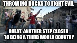 I missed this act of genius. Schools would have grade schoolers protect themselves with rocks before arming adults??? | THROWING ROCKS TO FIGHT EVIL GREAT. ANOTHER STEP CLOSER TO BEING A THIRD WORLD COUNTRY | image tagged in rocks,school shooting,memes | made w/ Imgflip meme maker