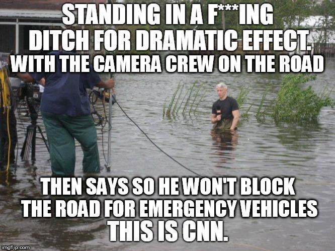 WITH THE CAMERA CREW ON THE ROAD THEN SAYS SO HE WON'T BLOCK THE ROAD FOR EMERGENCY VEHICLES | image tagged in cnn | made w/ Imgflip meme maker