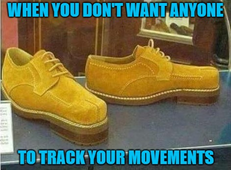 Damn...now that I found this picture, I want a pair. | WHEN YOU DON'T WANT ANYONE TO TRACK YOUR MOVEMENTS | image tagged in backward shoes,memes,fake tracks,funny,shoes,misdirection | made w/ Imgflip meme maker