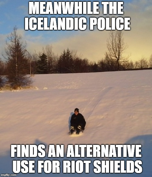 MEANWHILE THE ICELANDIC POLICE FINDS AN ALTERNATIVE USE FOR RIOT SHIELDS | image tagged in AdviceAnimals | made w/ Imgflip meme maker