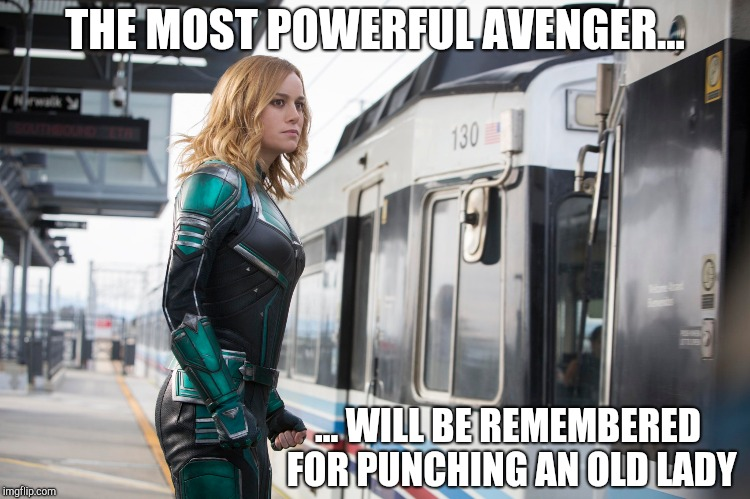 Captain Marvel - Punches Old Ladies | THE MOST POWERFUL AVENGER... ... WILL BE REMEMBERED FOR PUNCHING AN OLD LADY | image tagged in mcu,captain marvel,marvel,carol danvers,brie larson,marvel comics | made w/ Imgflip meme maker