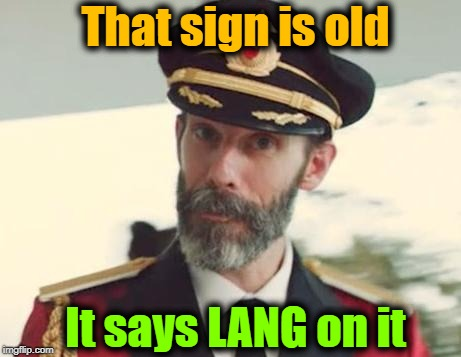 Captain Obvious | That sign is old It says LANG on it | image tagged in captain obvious | made w/ Imgflip meme maker