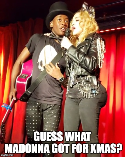 GUESS WHAT MADONNA GOT FOR XMAS? | image tagged in madonna,butt,madonna strike a pose | made w/ Imgflip meme maker