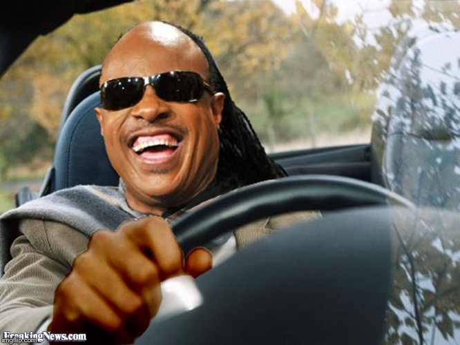 Stevie Wonder Driving | . | image tagged in stevie wonder driving | made w/ Imgflip meme maker