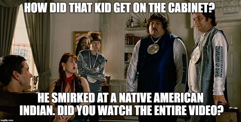 idiocracy | HOW DID THAT KID GET ON THE CABINET? HE SMIRKED AT A NATIVE AMERICAN INDIAN. DID YOU WATCH THE ENTIRE VIDEO? | image tagged in idiocracy | made w/ Imgflip meme maker