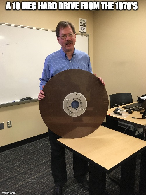 Technology has come a long way | A 10 MEG HARD DRIVE FROM THE 1970'S | image tagged in hard drive,old technology | made w/ Imgflip meme maker