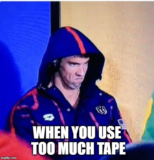 Michael Phelps Death Stare | WHEN YOU USE TOO MUCH TAPE | image tagged in memes,michael phelps death stare | made w/ Imgflip meme maker