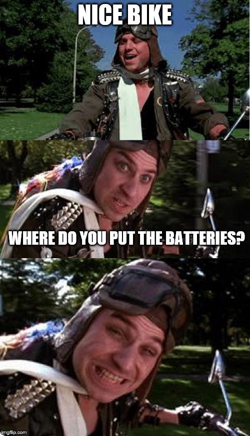 Bad Pun Bobcat Goldthwait | NICE BIKE WHERE DO YOU PUT THE BATTERIES? | image tagged in bad pun bobcat goldthwait | made w/ Imgflip meme maker