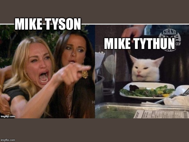 white cat table | MIKE TYSON MIKE TYTHUN | image tagged in white cat table | made w/ Imgflip meme maker