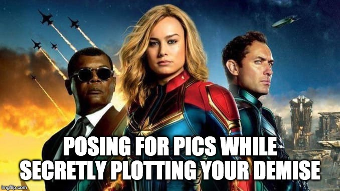 badass Captian marvel |  POSING FOR PICS WHILE SECRETLY PLOTTING YOUR DEMISE | image tagged in marvel,badass | made w/ Imgflip meme maker