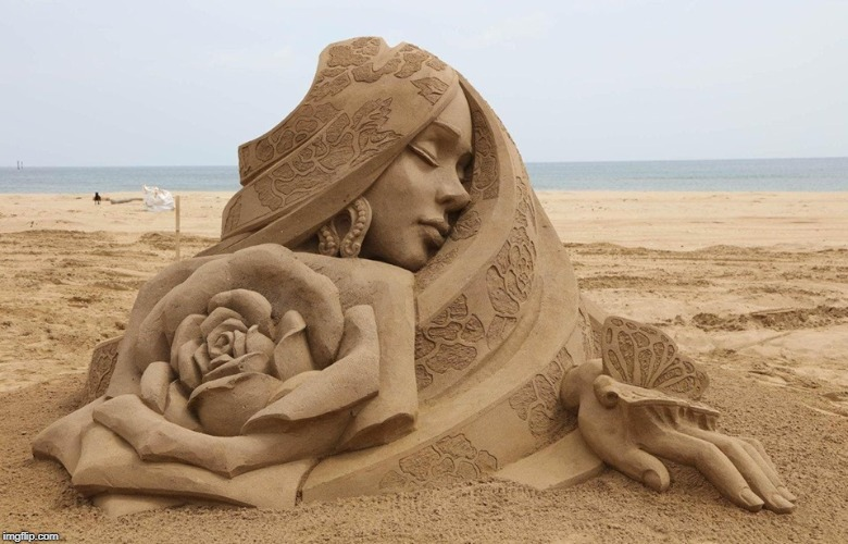 Sleeping Girl with Butterfly and Rose | image tagged in vince vance,sand,sculpture,expert level,flower,butterfly | made w/ Imgflip meme maker