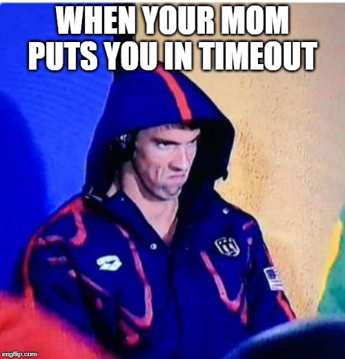Michael Phelps Death Stare |  WHEN YOUR MOM PUTS YOU IN TIMEOUT | image tagged in memes,michael phelps death stare | made w/ Imgflip meme maker
