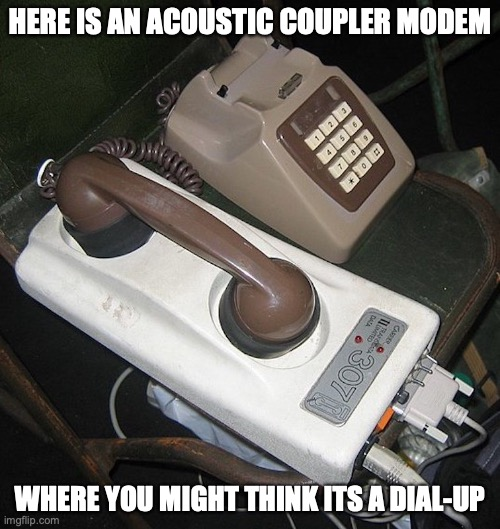 Modem |  HERE IS AN ACOUSTIC COUPLER MODEM; WHERE YOU MIGHT THINK ITS A DIAL-UP | image tagged in modem,internet,memes | made w/ Imgflip meme maker