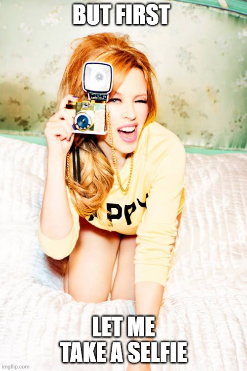 Kylie |  BUT FIRST; LET ME TAKE A SELFIE | image tagged in kylie minogue with a camera | made w/ Imgflip meme maker