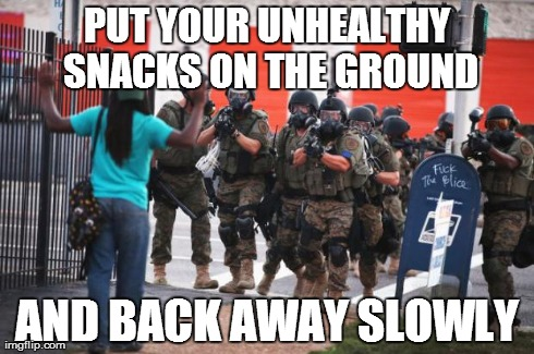 It looks like the First Lady got involved down in Ferguson, MO. . . | PUT YOUR UNHEALTHY SNACKS ON THE GROUND AND BACK AWAY SLOWLY | image tagged in us police,ferguson,healthy snack,first lady | made w/ Imgflip meme maker