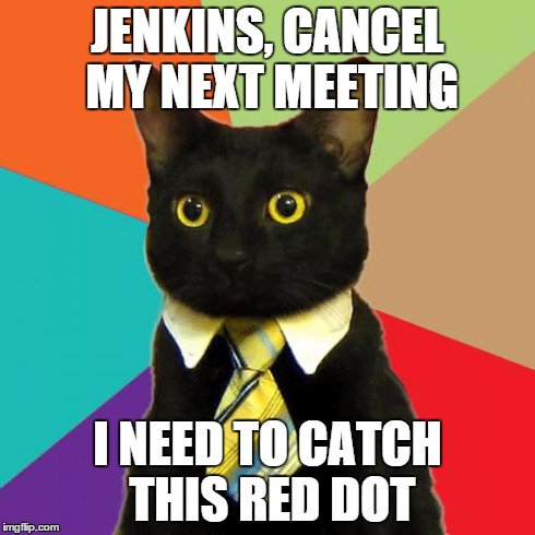 Catz with frikkin' lazer beamz | JENKINS, CANCEL MY NEXT MEETING I NEED TO CATCH THIS RED DOT | image tagged in memes,business cat,laser | made w/ Imgflip meme maker