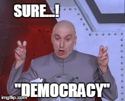 "That's what the system wants us to believe and this is what we tell them. | SURE...! ""DEMOCRACY"" 