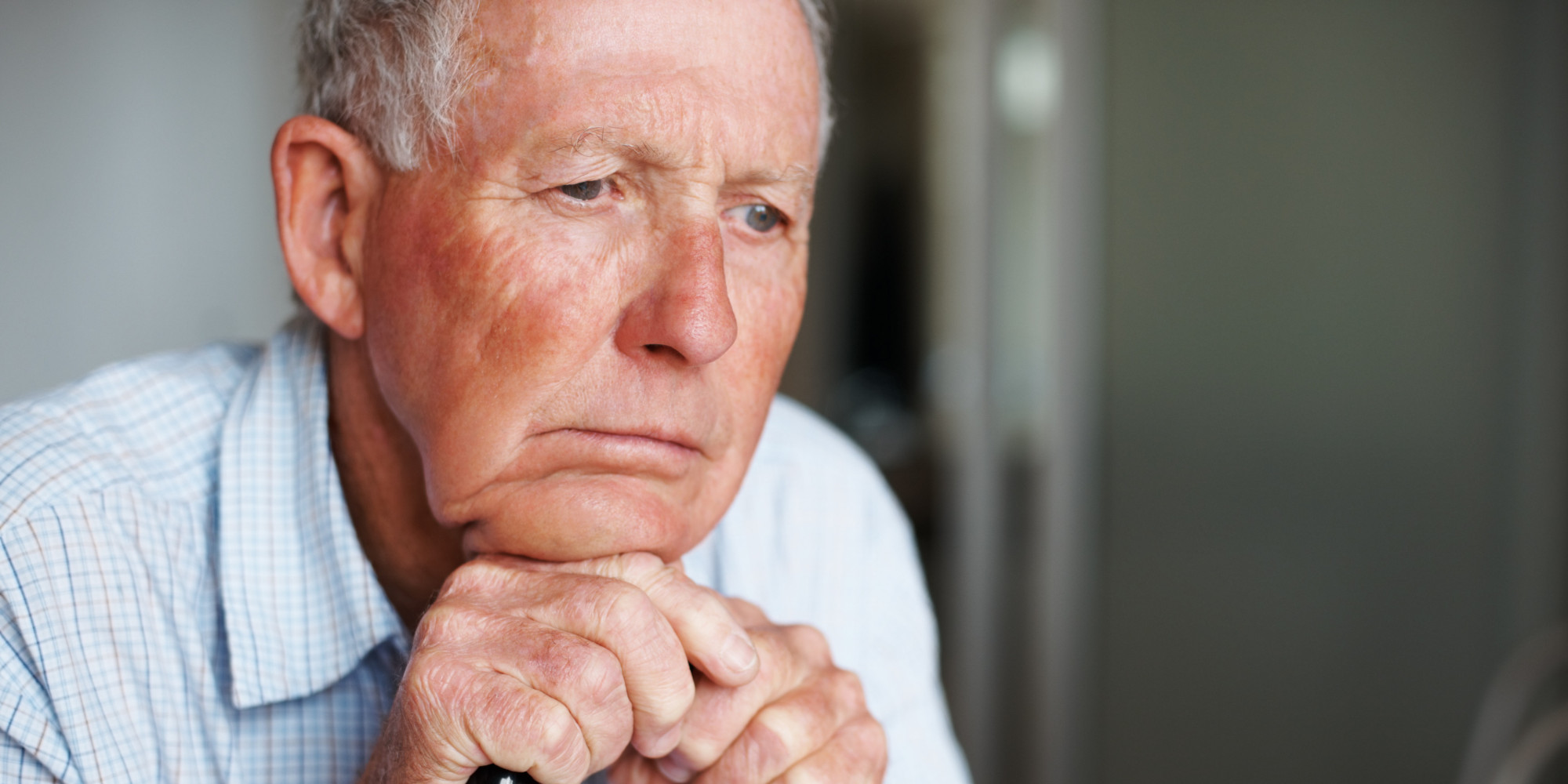 disappointed old man Emotional moment: man sitting holding head in hands, stressed sad young male having mental problems, feeling bad, depressed, disappointed, hopeless desperate man in the dark corner needing help businessmen get bad news, read messages in the mail, have tense expressions, anxiety, and use the mind to find a way out.