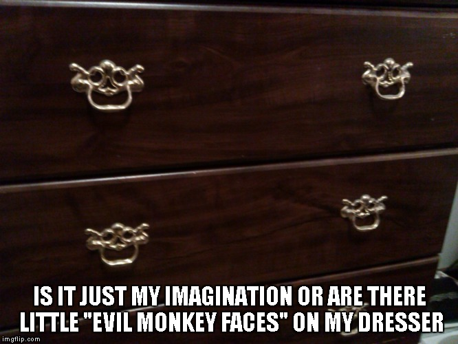 "This is my actual dresser and I just realized how creepy the handles are. | IS IT JUST MY IMAGINATION OR ARE THERE LITTLE ""EVIL MONKEY FACES"" ON MY DRESSER 