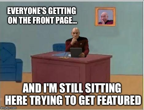 Picard at Desk | EVERYONE'S GETTING ON THE FRONT PAGE... AND I'M STILL SITTING HERE TRYING TO GET FEATURED | image tagged in picard at desk,memes | made w/ Imgflip meme maker